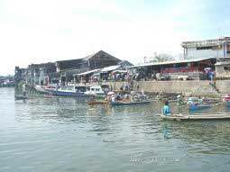 Landing of the Public Boat in the Harbour of Manado
